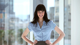 Smiling brunette businesswoman placing her hands o Footage