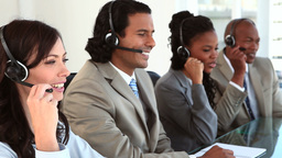 Happy call centre agents wearing headsets Footage