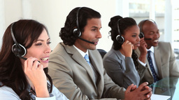 Happy business people using their headsets Footage