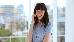 Happy brunette businesswoman using her cellphone Footage