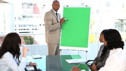 Smiling businessman making a presentation Footage