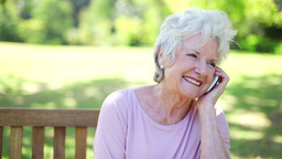 Retired woman talking on the phone Stock Video Footage