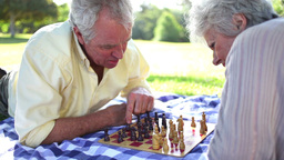 Retired people playing chess on the ground Stock Video Footage