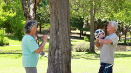 Smiling mature couple playing with a soccer ball Stock Video Footage