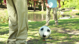 Soccer game being played by two members of a famil Stock Video Footage