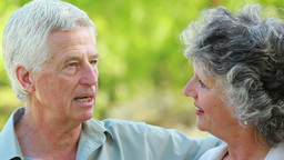 Smiling mature woman listening to her husband Stock Video Footage