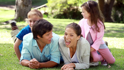 Smiling parents chatting and then their children a Stock Video Footage