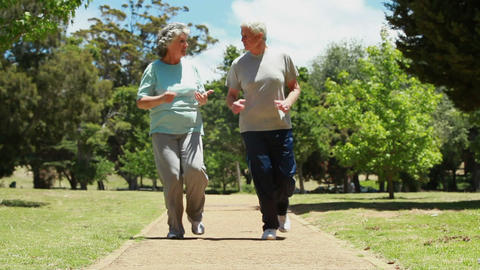 Smiling mature couple jogging together Stock Video Footage