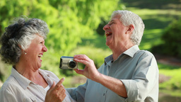 Smiling mature couple taking themselves in picture Footage
