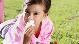 Little girl holding a beautiful flower Stock Video Footage