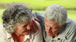 Smiling mature couple lying on the grass Stock Video Footage