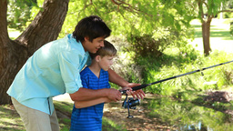 Happy father and son using a fishing rod Stock Video Footage