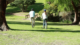 Couple spending time together while riding bikes Footage