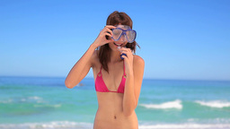 Smiling woman wearing a mask and a snorkel Footage