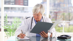 Mature practitioner holding documents Footage