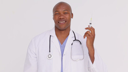 Smiling doctor holding a syringe Footage