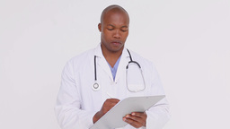 Serious doctor holding a clipboard Stock Video Footage