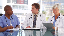Medical team talking to each other Footage