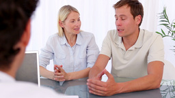 Smiling couple talking with their doctor Stock Video Footage
