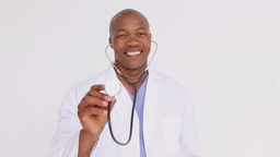 Smiling doctor proudly showing his stethoscope Stock Video Footage