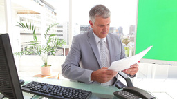 Businessman looking at sheets Stock Video Footage