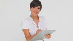 Businesswoman writing on a clipboard Footage