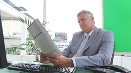 Businessman reading a newspaper Footage