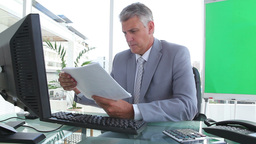 Businessman reading documents Stock Video Footage