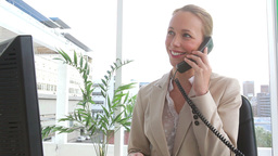 Businesswoman ending a phone call Footage