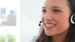 Businesswoman smiling while talking on a headset Stock Video Footage