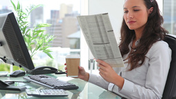 Businesswoman reading a newspaper Stock Video Footage