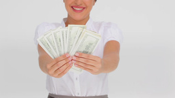 Businesswoman holding a fan of dollars Stock Video Footage