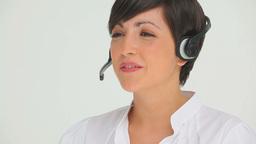 Brunette businesswoman talking on a headset Footage