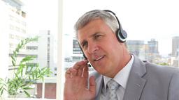 Businessman talking on a headset Footage