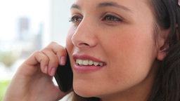Businesswoman smiling as she talks on a phone Stock Video Footage