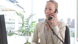 Happy businesswoman talking on a phone Stock Video Footage