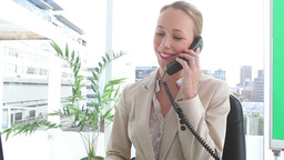Happy businesswoman talking on a phone Footage