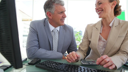 Two colleagues laughing together Stock Video Footage