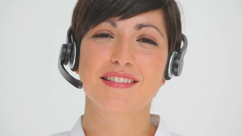 Businesswoman smiling while talking through a head Footage