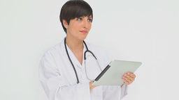 Doctor pressing the screen of a tablet computer Stock Video Footage
