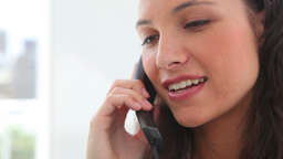 Brunette haired woman talking on the phone Footage