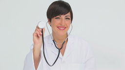Doctor holding the chestpiece of a stethoscope Footage