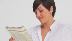Businesswoman smiling while reading a newspaper Footage