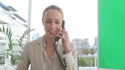 Happy businesswoman answering a telephone Stock Video Footage