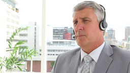 Serious businessman talking on a headset Footage