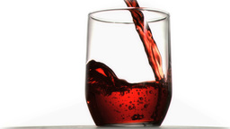 Red soda in super slow motion flowing in a glass Footage