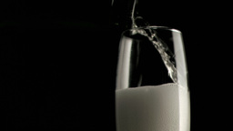 Champagne foam in a super slow motion filling a ch Stock Video Footage
