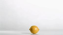 Syringe in super flow motion falling in a lemon Stock Video Footage