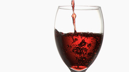 Red trickle in super slow motion flowing in a wine Stock Video Footage