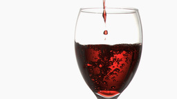 Red trickle in super slow motion flowing in a wine Footage